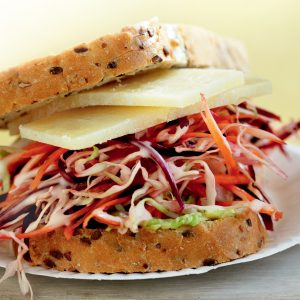 Avocado, shredded slaw and cheese sandwich