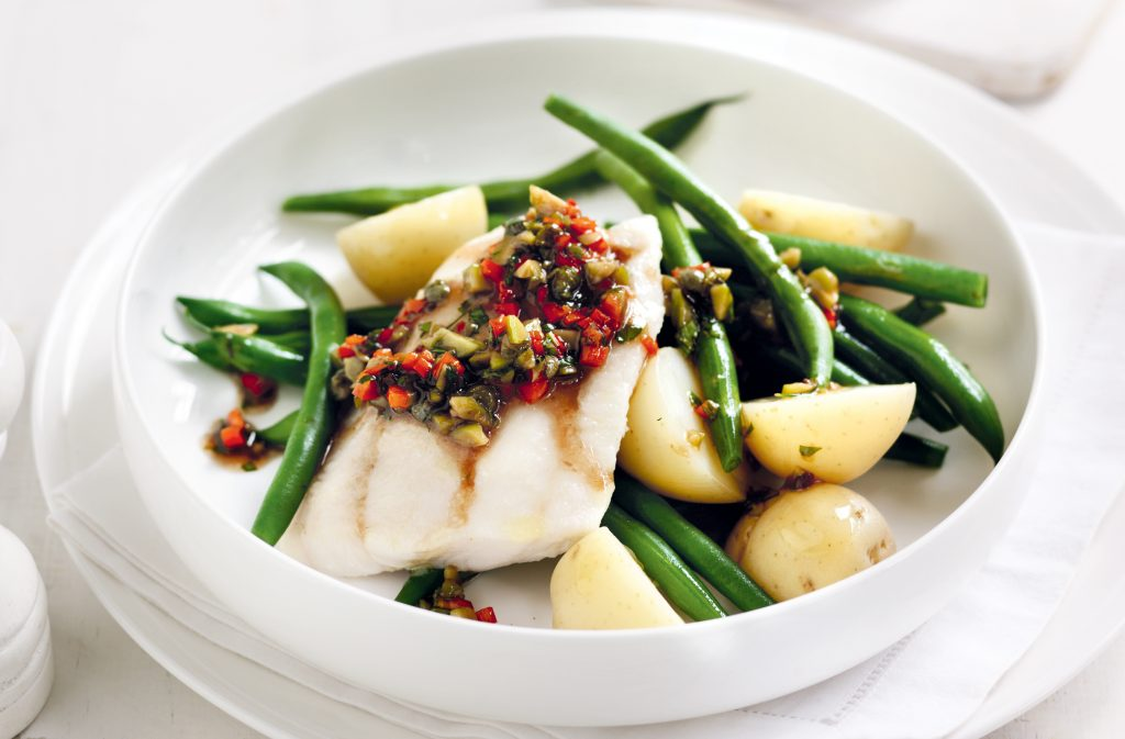 Baked fish with warm Niçoise dressing