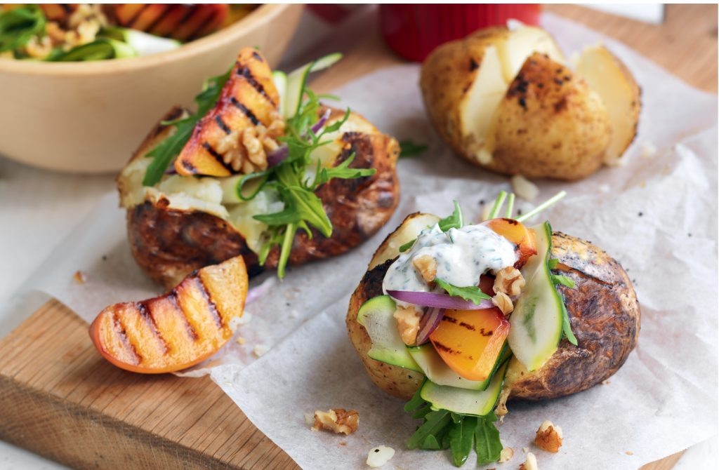 Baked potato with grilled peach salad