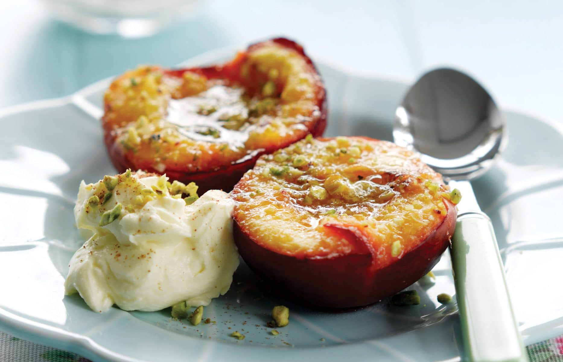 Baked stone fruit with pistachios