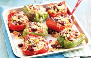 Cheesy rice and bean-stuffed capsicums