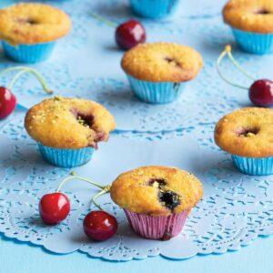 Cherry almond fairy cakes with pistachio dust
