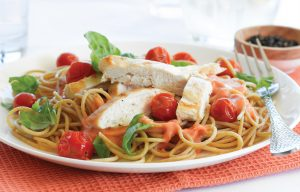 Chicken with roasted cherry tomatoes and basil