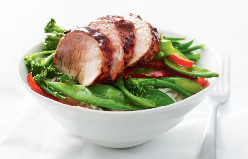 Chinese barbecued pork with stir-fried greens