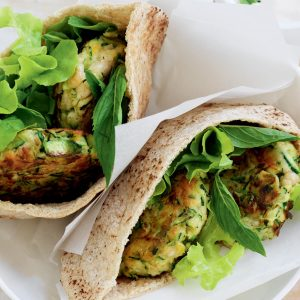 Courgette fritter-filled pitas with tzatziki