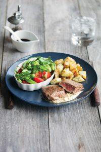 Mustard steak with tasty veg and salad