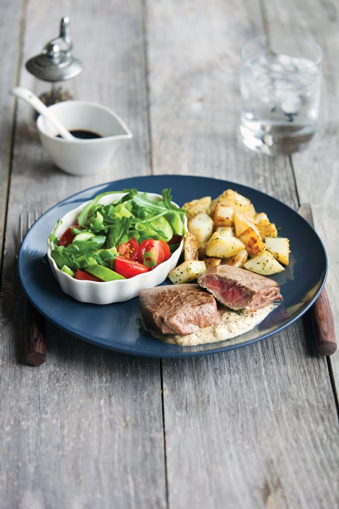 Mustard steak with tasty veg and salad