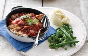 Fish with tomato, capers and mash