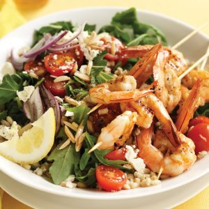 Grilled prawn skewers with barley and almond salad