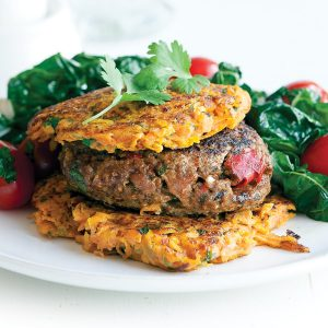 Lamb burgers with kumara fritters and silver beet