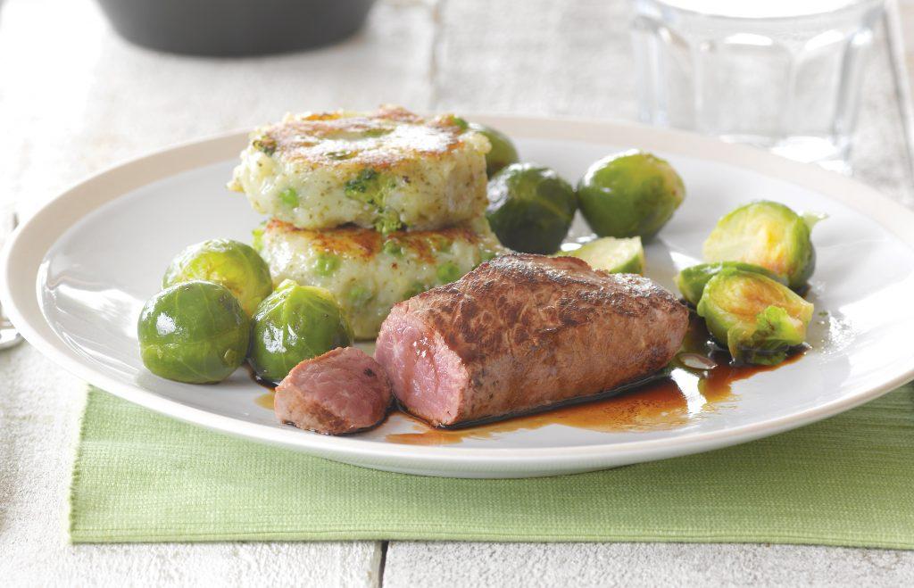 Lamb steak with pea and broccoli potato cakes