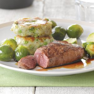 Lamb steak with pea and broccoli potato cakes