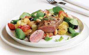 Lamb steaks with crushed bean and new potato salad