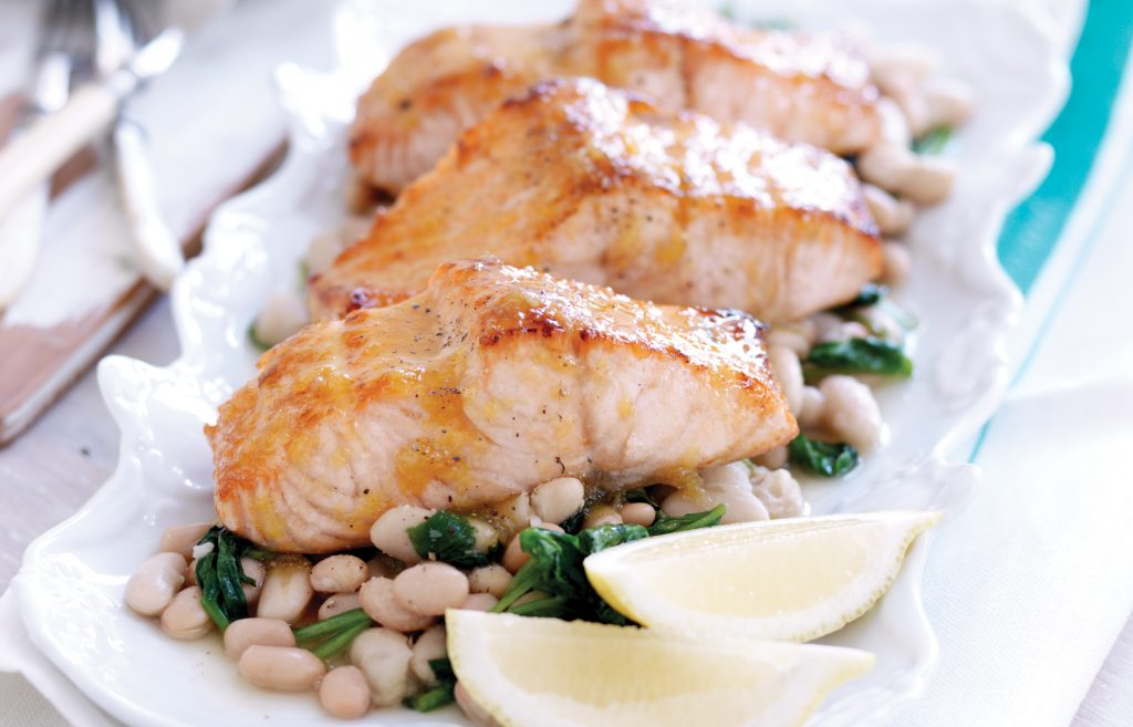 Maple-glazed salmon with spinach and white beans
