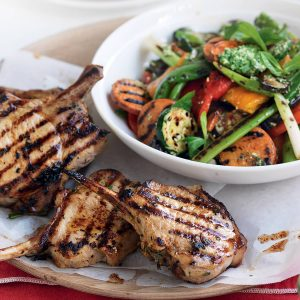 Marinated pork cutlets with charred veg and mint pesto