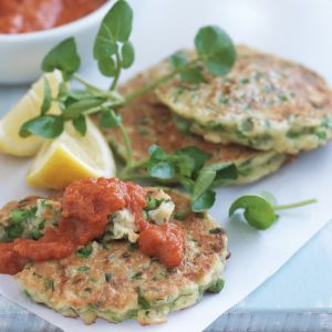 Pea, mint and haloumi fritters with tomato and capsicum sauce