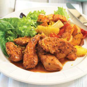 Portuguese chicken tenderloins on warm roasted vegetable salad