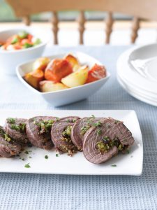 Roast lamb with fruity garlic stuffing
