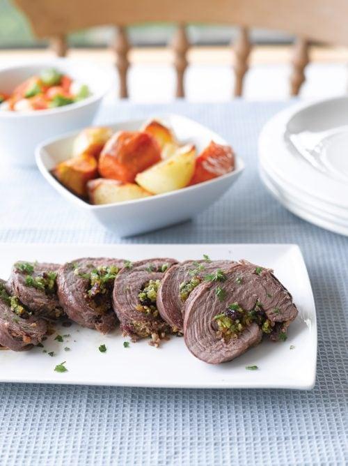 Roast lamb with fruity garlic stuffing