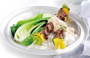 Satay beef skewers with Asian greens