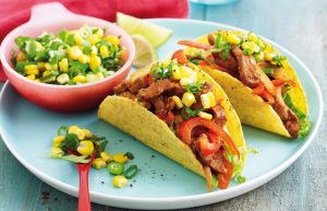 Sizzling pork tacos with corn and lime salsa