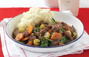 Slow-cooked beef with red wine and onions