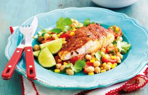 Spice-rubbed fish with roasted corn and tomato salad