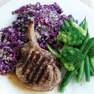 Spiced pork with red cabbage, bulgar and parsley salad