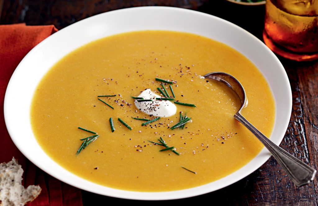 Spiced pumpkin soup with sour cream and chives