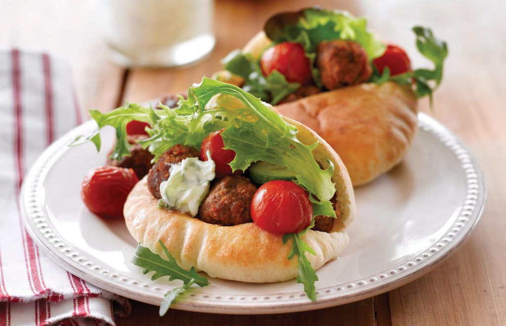 Spicy meatballs with roasted tomatoes and tzatziki