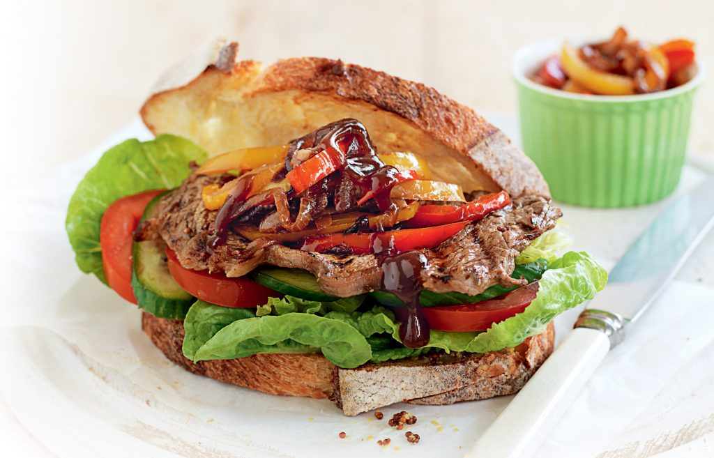 Steak sandwich with caramelised onion and capsicum