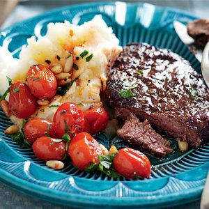 Steak with tomato relish on mustard mash