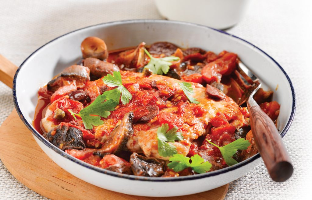 Tomato and olive chicken with almond couscous