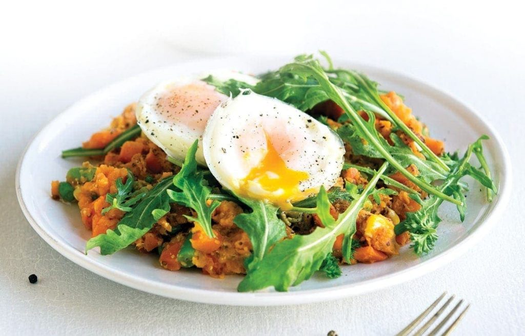 Vege kumara hash with rocket and poached eggs