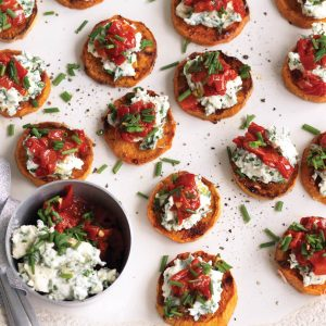 Roasted kumara with herb ricotta and capsicum salsa