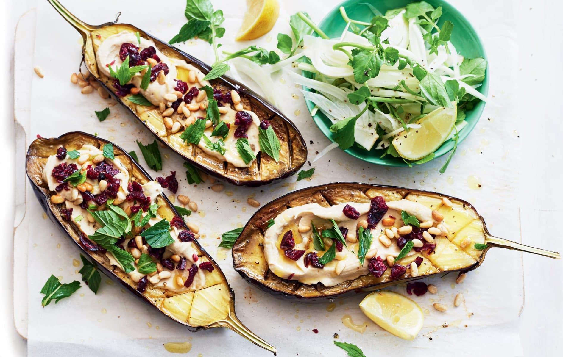 Baked eggplant with cranberry and mint