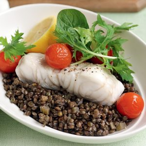 Baked fish with roasted tomatoes and lentils