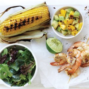 Barbecued prawn skewers with corn and mango chilli salsa