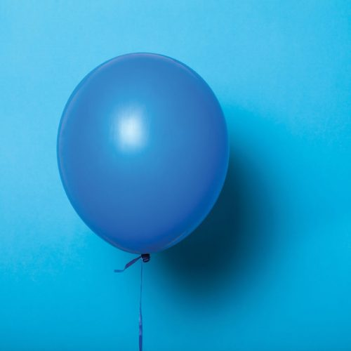 Blue balloon on a blue background