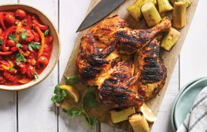 Butterflied harissa chicken with barbecued leek and lemon pepper sauce