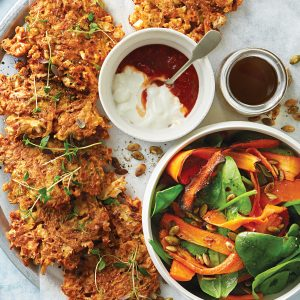 Cauliflower and potato fritters with winter spinach and roasted carrot salad