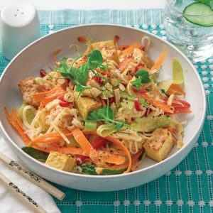 Cold rice noodle salad with crunchy veges, tempeh and honey-peanut dressing