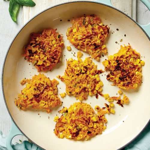Corn and pumpkin fritters with herby hummus