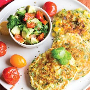 Corn fritters with chargrilled cherry tomatoes and avocado salsa