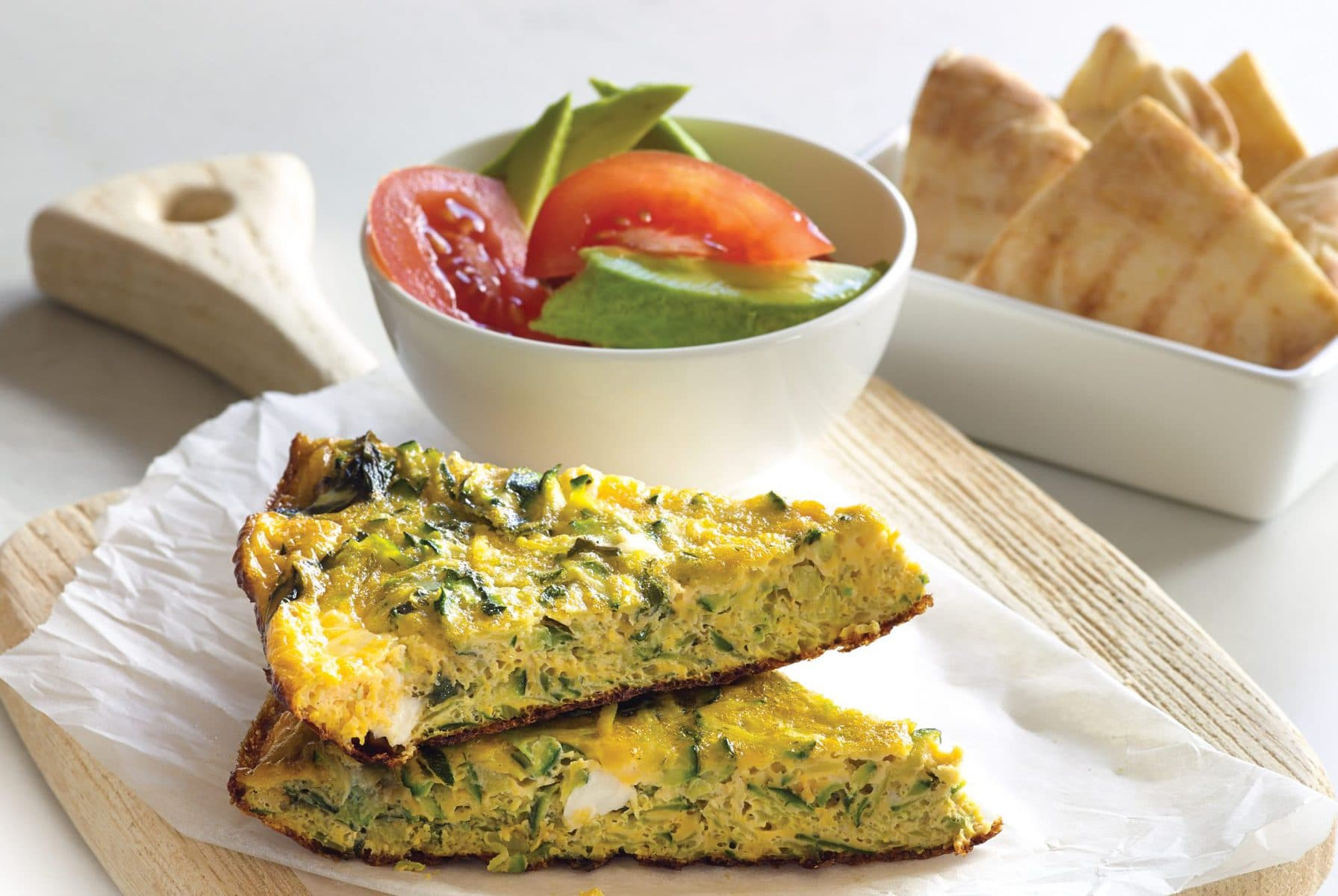Courgette, mint and feta omelette with pita wedges