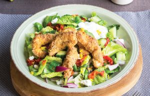 Crispy fish bites with salad and lemony dressing