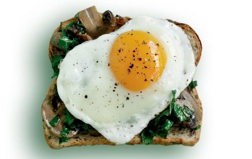Egg, mushroom and wilted kale toast topper