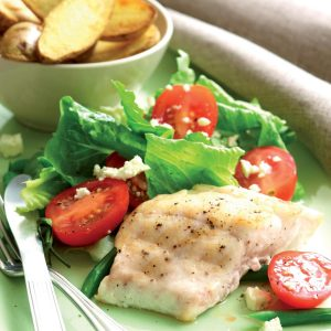 Fish and chips with tomato salad