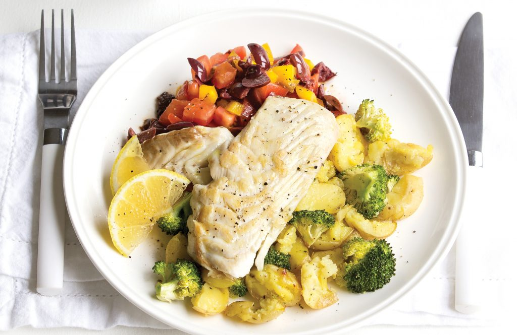 Fish with crushed potatoes and olive salad