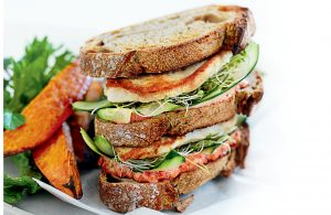 Grilled chicken club sandwich with kumara wedges